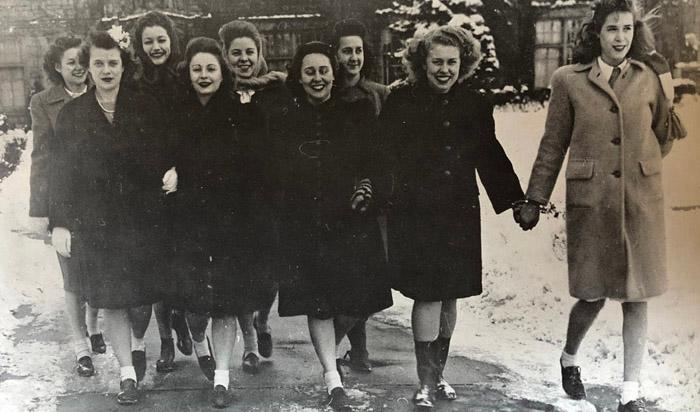 Young women walking on campus in the winter of 1945